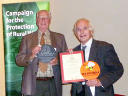Alan Michie, Chair of BFM receives the award from Jean Rosenfield, Chair CPRW